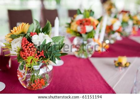 Wedding flowers - tables set for wedding - stock photo