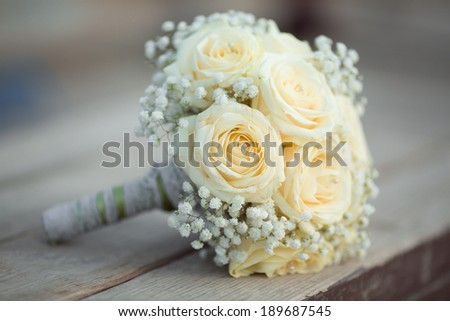 Wedding flowers white roses bouquet. Marriage flowers bouquet. sunset.