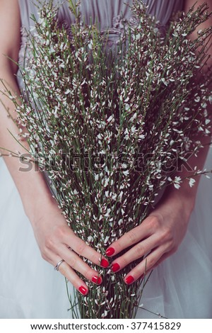 Wedding flowers ,Woman holding colorful bouquet with her hands on wedding day. - stock photo