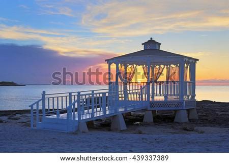 wedding gazebo at sunset - stock photo