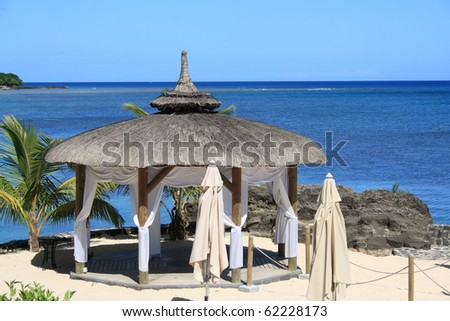 wedding gazebo on the beach in front of the ocean - stock photo