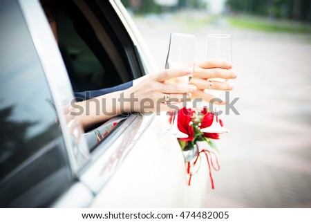 wedding glass in the hands with rings