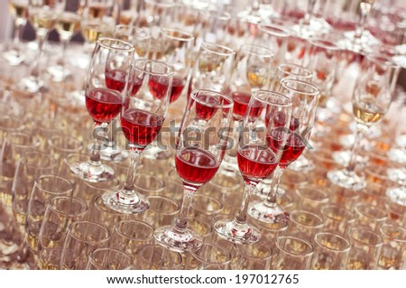 Wedding glasses filled with wine and champagne  - stock photo