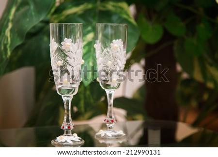 wedding glasses on green background - stock photo