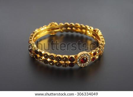 Wedding gold bracelets - stock photo