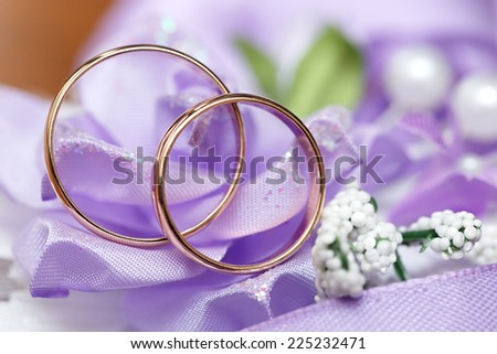 Wedding gold ring, decorations for a wedding celebration. - stock photo