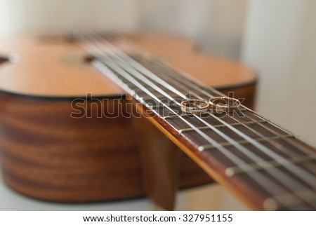 wedding gold rings on guitar. wedding concept - stock photo