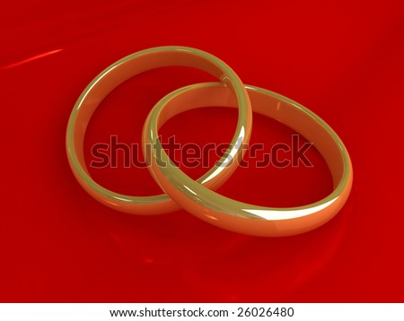 Wedding gold rings on red velvet