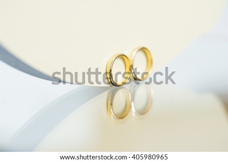 wedding golden rings on glass surface