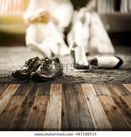 Wedding groom and bride shoes with married couple on luxury bed background  with wooden floor