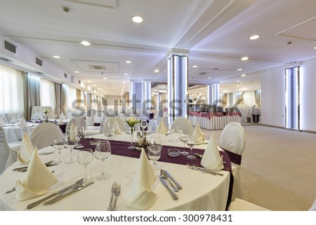 Wedding hall or other function facility set for fine dining  - stock photo