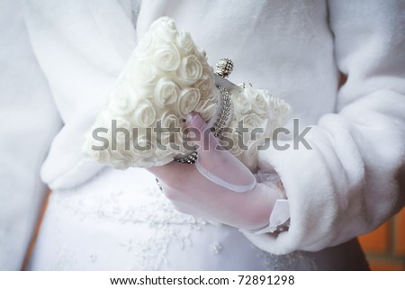wedding handbag in bride's hand