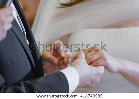 Wedding hands between husband and wife with ring during the celebration of marriage