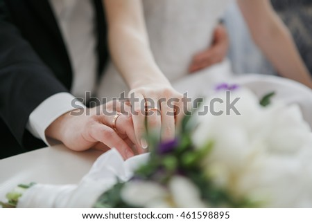 Wedding hands of a bride and groom