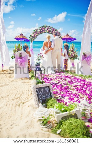 wedding in bali (focus on the board with text)