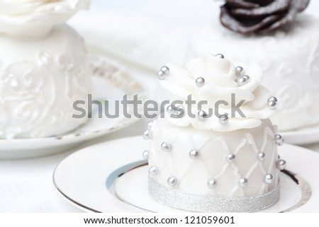 wedding individual cakes in the plates - stock photo