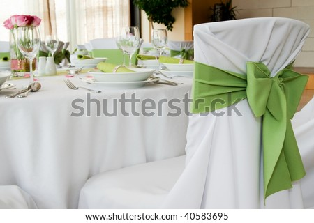Wedding interior with decorated chair - stock photo