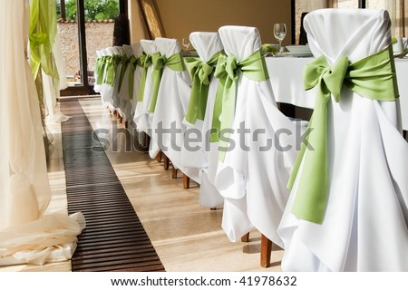 Wedding interior with row of chairs - stock photo