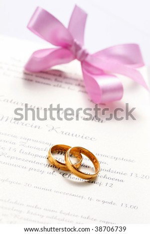 wedding invitation and two rings