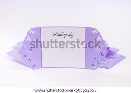 Wedding invitation. Cutting, decorated with purple ribbon, embossed.