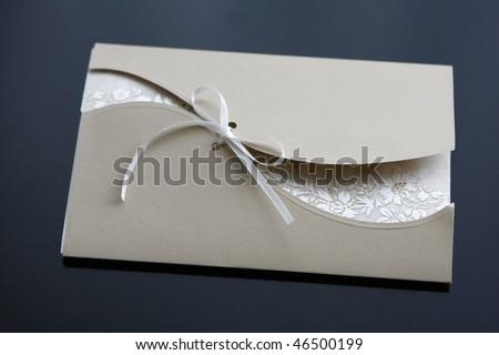 wedding invitation isolated on black - stock photo