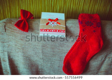 One green gift box green ribbon stock photo 540467953 shutterstock wedding invitation letter lies between red bow tie and red socks stopboris Choice Image