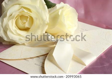 Wedding invitation on pink silk - stock photo