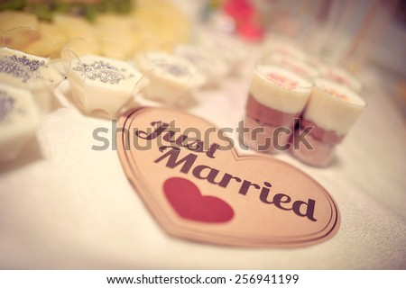 Wedding Just Married sign on a candy table - stock photo