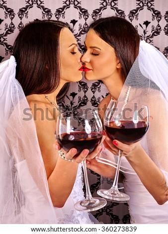 Wedding lesbians girl in bridal dress. - stock photo