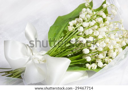 Wedding lily of the valley bouquet - stock photo