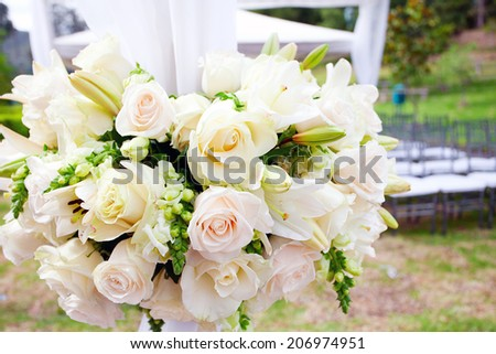 wedding marquee with bouquets of roses - stock photo