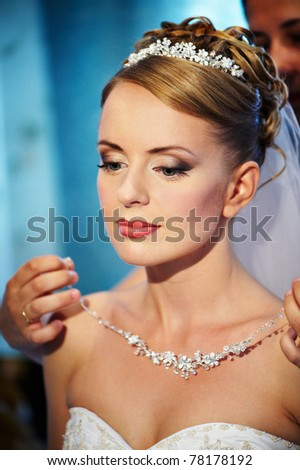 Wedding necklaces Brides in hands of groom - stock photo