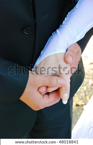 Wedding of a hand of a newly-married couple