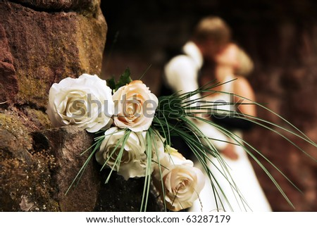 Wedding on a castle with romantic white roses - stock photo