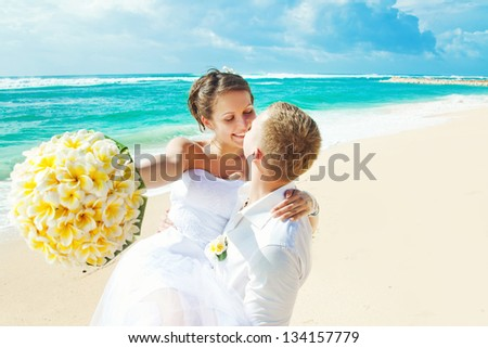 wedding on beach (focus on eyes of bride)