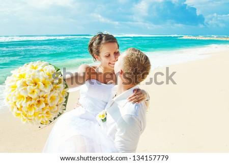 wedding on beach (focus on eyes of bride) - stock photo