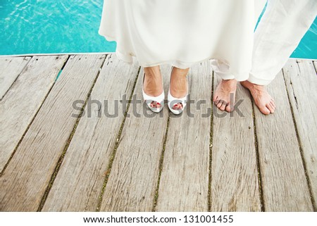 Wedding on the beach (foot closeup) - stock photo