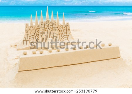 Wedding on the beach. Sand castle to decorate the wedding ceremony. Tropical sea in the background. - stock photo