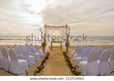 wedding on the beach scene with sunset - stock photo
