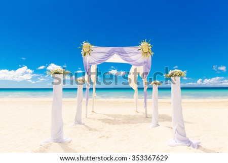Wedding on the beach . Wedding arch decorated with flowers on tropical sand beach. - stock photo
