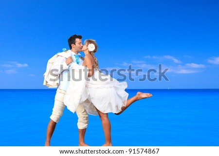 Wedding on the beach, young married couple on the beach - stock photo