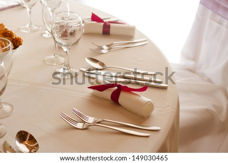 wedding or dinner table place setting, fork, spoon and knife in elegant setting - colorized photo - stock photo