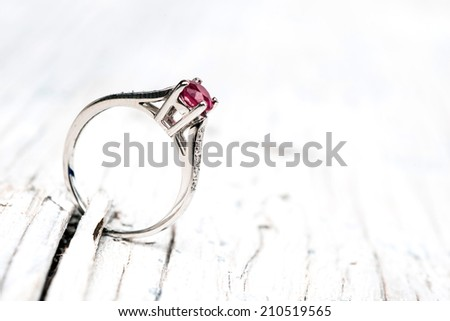 Wedding or Engagement Ring on wood