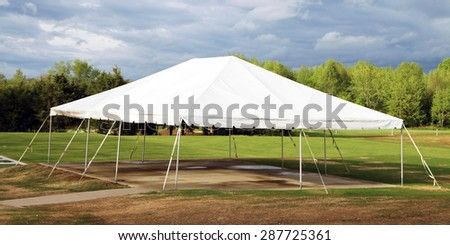 Wedding or party tent set up on a golf course. - stock photo
