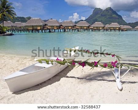 Wedding paradise polynesian beach with romantic canoe - stock photo