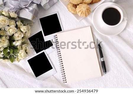 Wedding photo album, instant prints, white copy space - stock photo