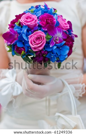 wedding photo. Bride holding bouquet - stock photo