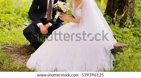 wedding photo, groom and bride together, young newlywed couple