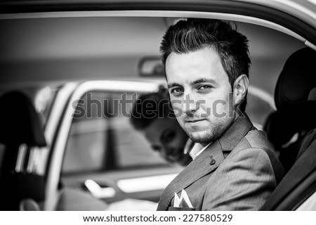 Wedding photo, groom in the car