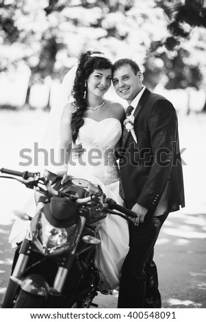 Wedding photo session with motorcycle - stock photo